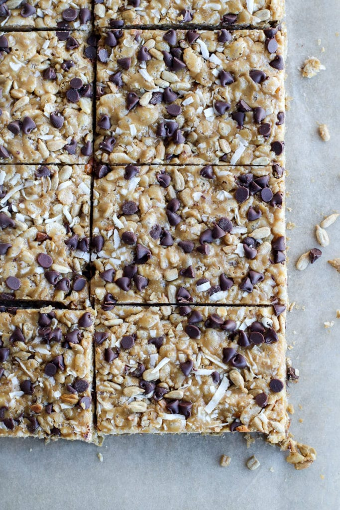 Freshly cut chocolate chip granola bars on a piece of parchment paper