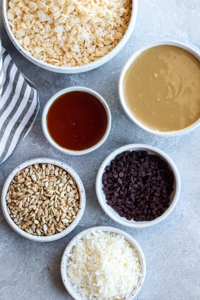 All ingredients for Crispy Chocolate Chip Granola Bars in small white bowls.