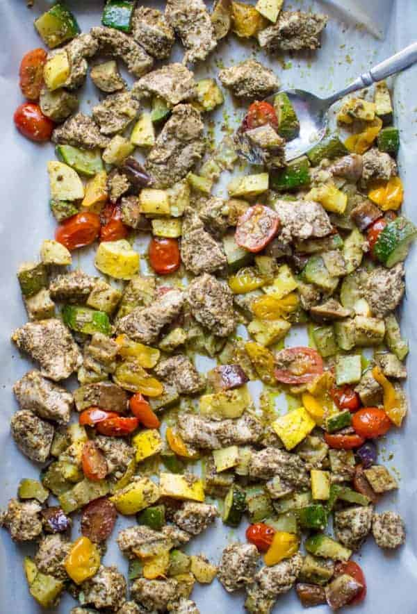 Thirty Whole30 Sheet Pan Recipes Pesto Chicken with Summer Veggies in a sheet pan