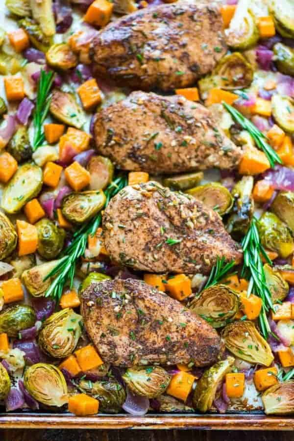 Thirty Whole30 Sheet Pan Recipes Sheet Pan Chicken Sweet Potatoes Apples and Brussel Sprouts in a sheet pan