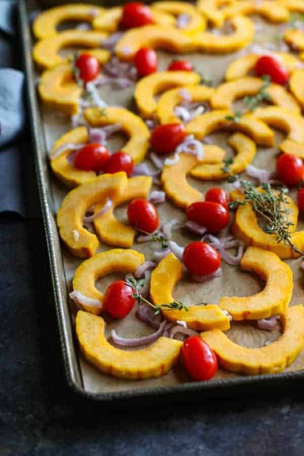 Roasted Delicata Squash with Tomatoes   healthy squash recipes   healthy side dishes   how to roast delicata squash   delicata squash recipes   Whole30 side dishes   gluten free side dishes   dairy free side dishes   paleo side dishes    The Real Food Dietitians