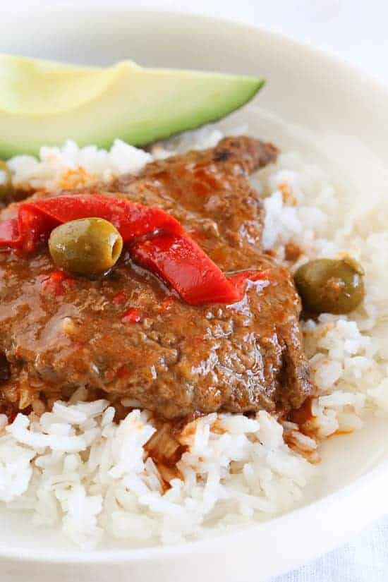 Slow cooker cubed steak with peppers and onions on rice