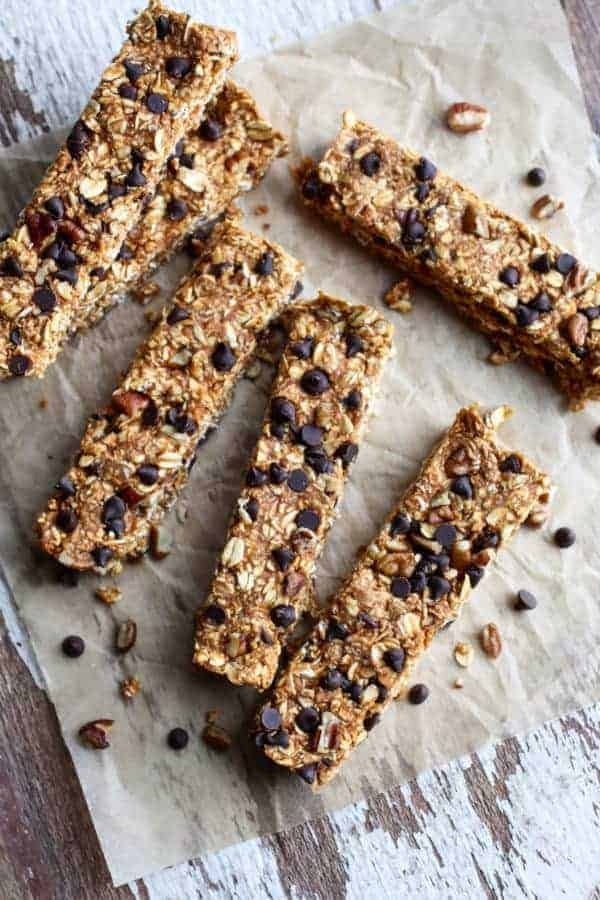 No-Bake Pumpkin Chocolate Chip Granola Bars laid out on a table top