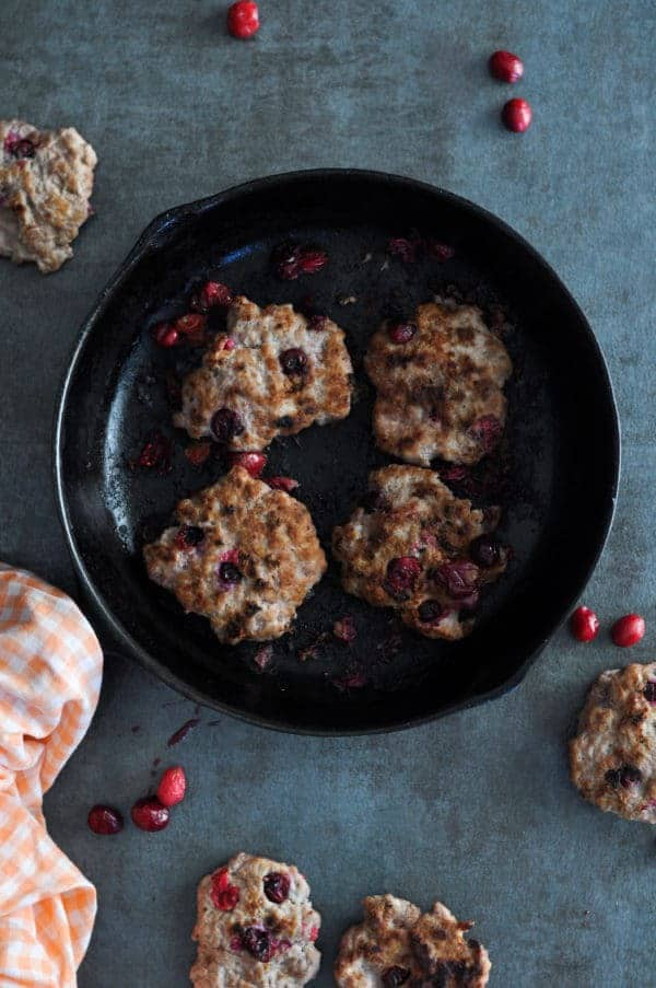 Overhead view of Cranberry Breakfast Sausage Patties in a skillet