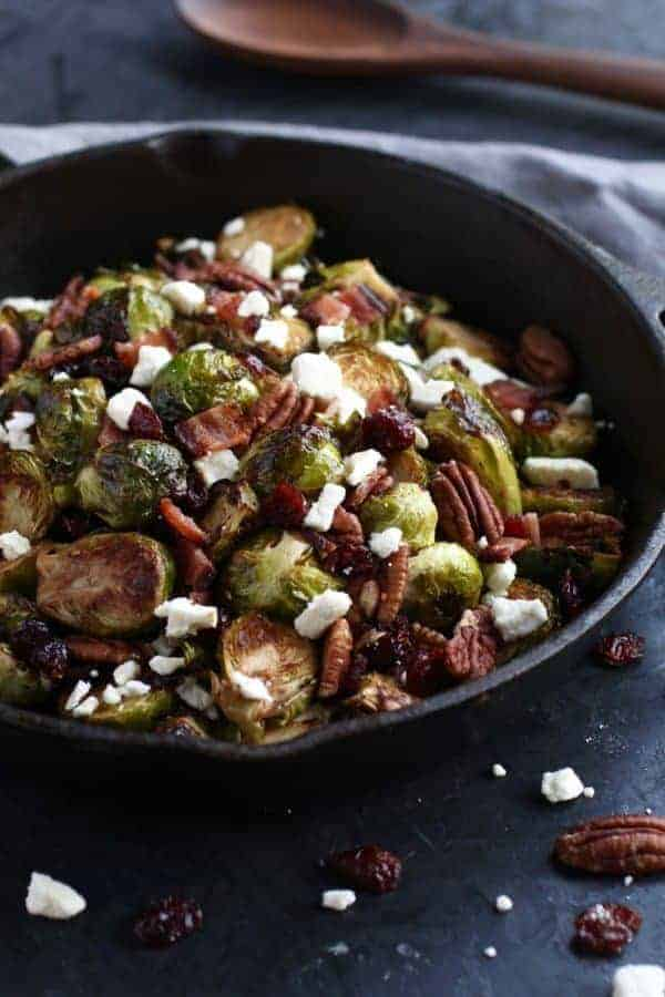 Roasted Brussels with Bacon & Feta | easy Brussels sprouts recipes | healthy Brussels sprouts recipe | gluten-free side dish | grain-free side dish | egg-free side dish | paleo side dish | how to cook Brussels sprouts || The Real Food Dietitians #brusselssprouts #glutenfreesidedish #paleorecipe