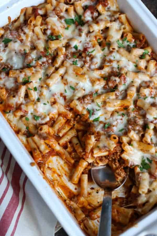 baked ziti in a white baking dish with spoon