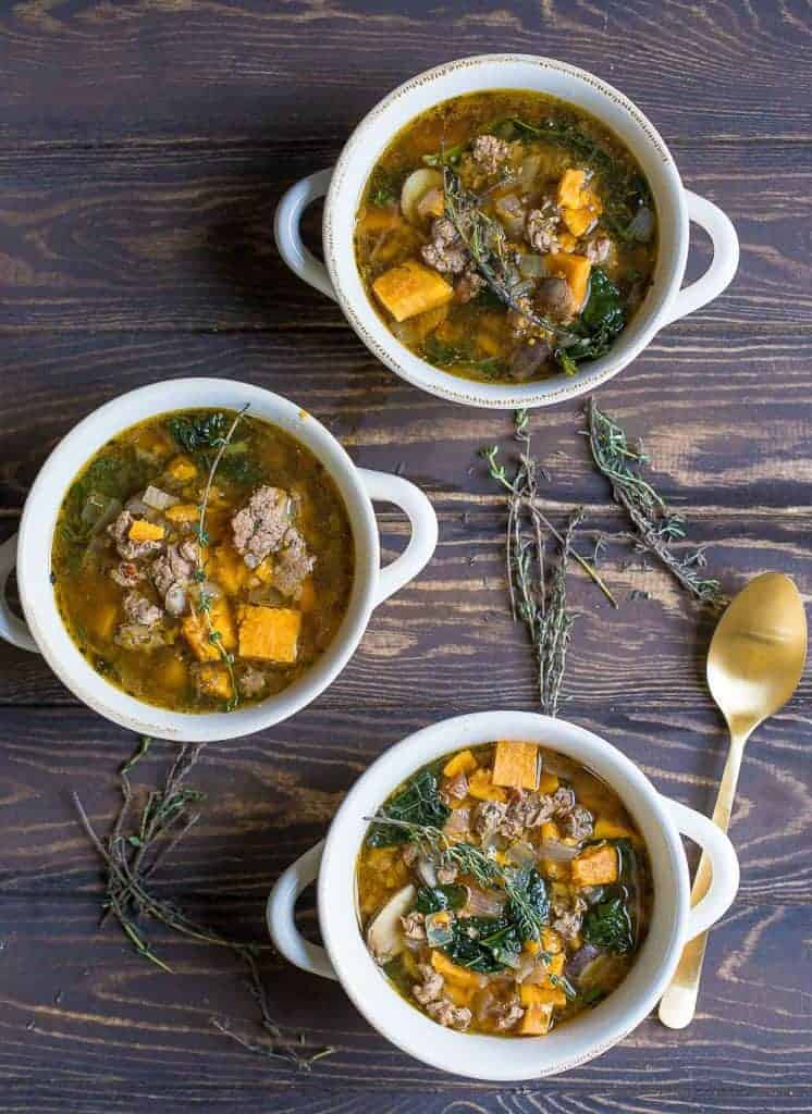 Instant Pot or Slow Cooker Sausage Kale and Sweet Potato Soup from Wholesomelicious | 30 Whole30 Soups, Stews & Chilis | healthy soup recipes | whole30 meal ideas | whole30 recipes | whole30 chili recipes || The Real Food Dietitians #whole30soups #whole30recipe #whole30meals