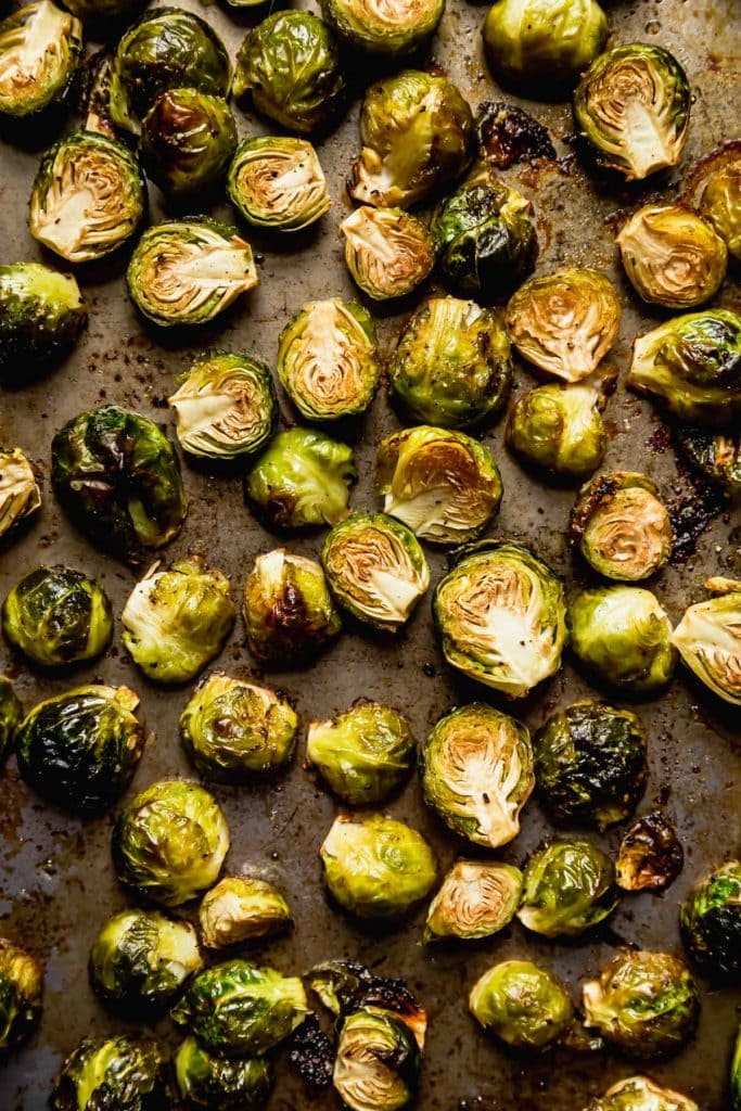 Roasted Brussels Sprouts with Bacon on a pan.