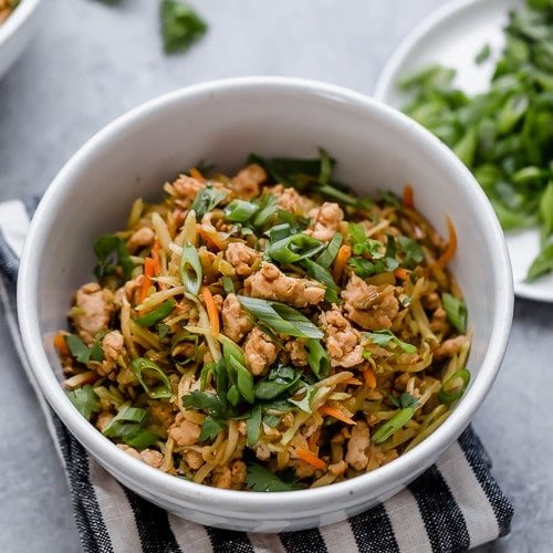 Egg roll in a bowl made with ground chicken, veggies, and homemade sauce in a white bowl