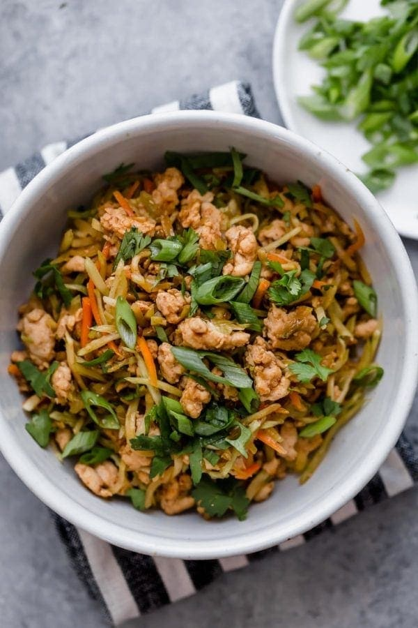 Easy egg roll in a bowl served in a white bowl topped with scallions