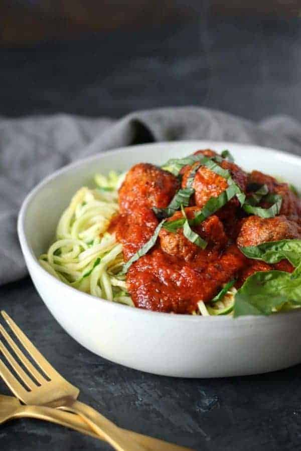 meatballs and marinara on zucchini noodles in a bowl