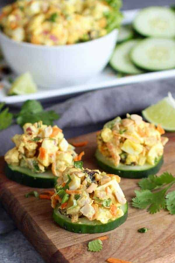 Egg salad topped on cucumber slices.