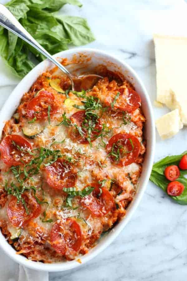 pepperoni pizza quinoa bake with a serving spoon