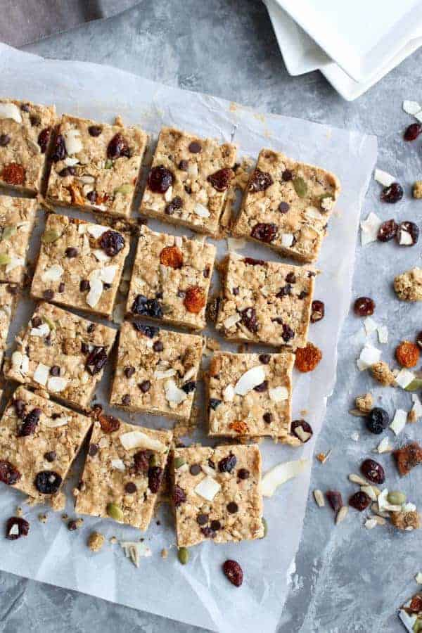 Homemade granola bars on parchment paper.
