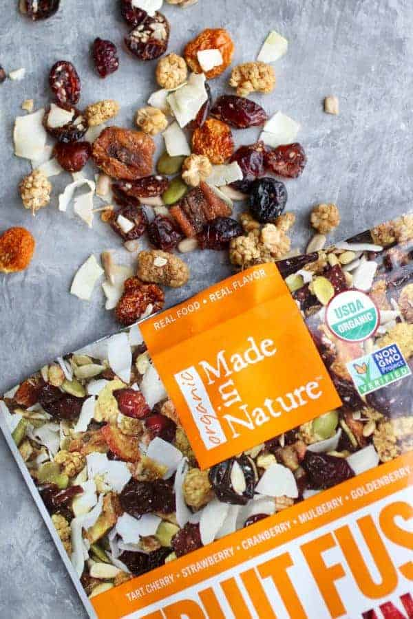 Bag of Made In Nature Fruit Fusion with trail mix coming out of bag.