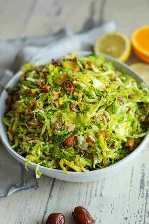 Shredded Brussels sprouts salad in a bowl on picnic table