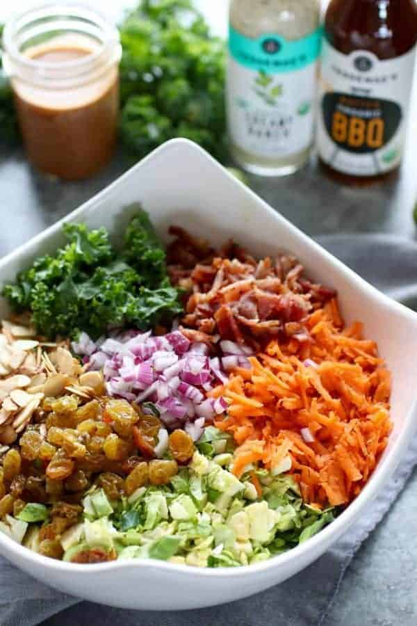 BBQ Ranch Chopped Salad with Brussels Sprouts & Kale ingredients in a white bowl