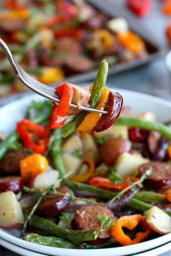 One-Pan Kielbasa Veggie Bake on a silver fork