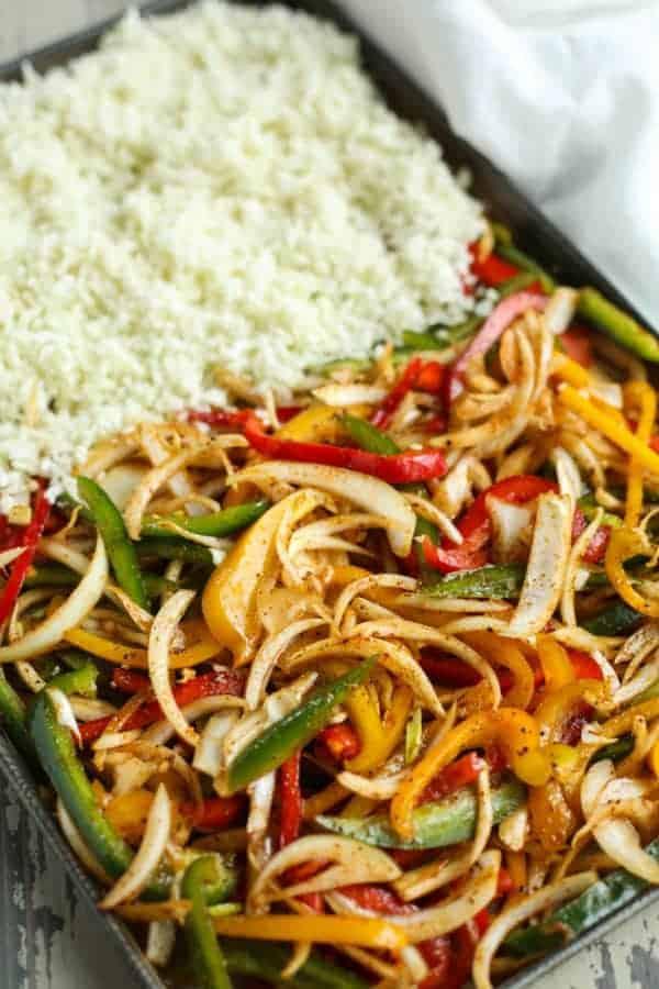 One-Pan Shrimp Fajita Bowls ingredients on a cooking sheet