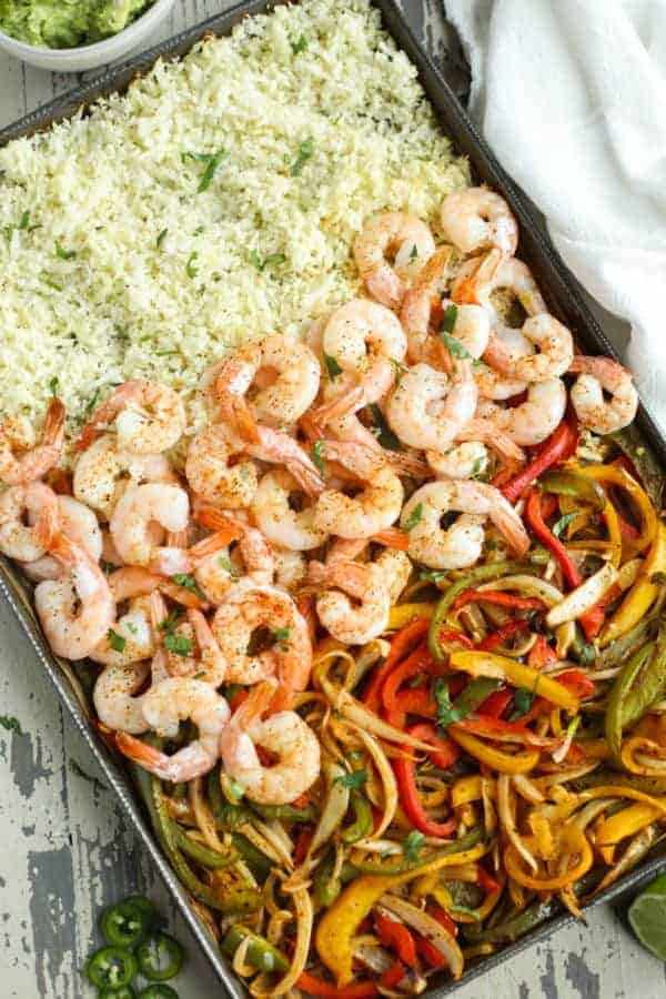 One-Pan Shrimp Fajita Bowls cooked ingredients on a cookie sheet