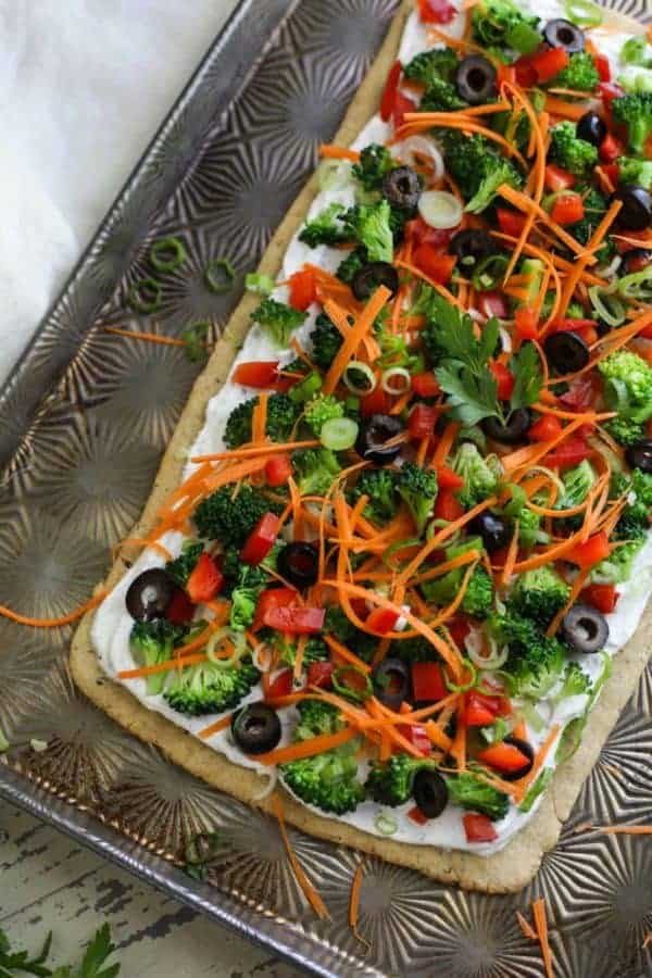 uncooked Gluten-free Veggie Pizza on a baking sheet