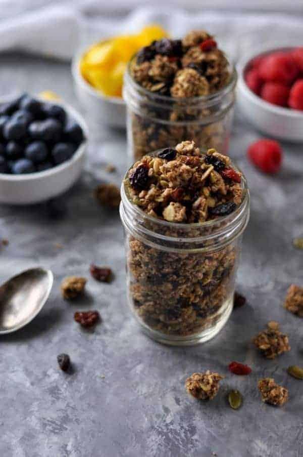 Side view of Nut-free Paleo Granola in a mason jar.