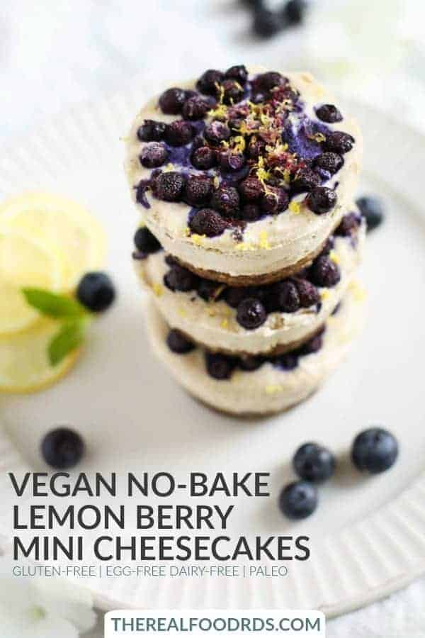 Vegan No-Bake Lemon Berry Mini Cheesecakes stacked in a column of 3 cakes