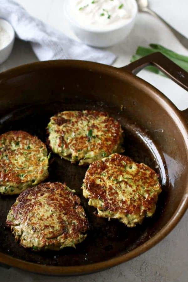 Savory Zucchini Fritters in a skillet