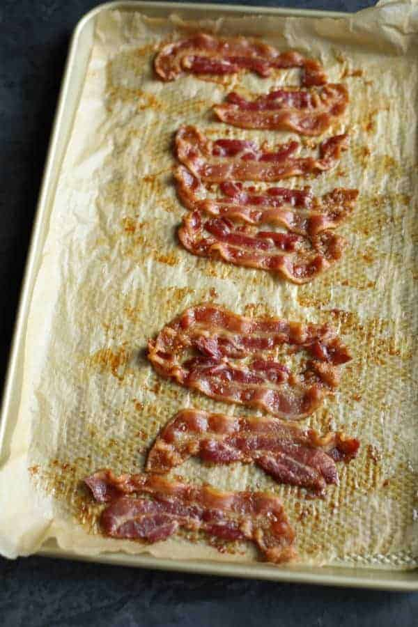 aerial view of bacon strips cooling on a cookie sheet