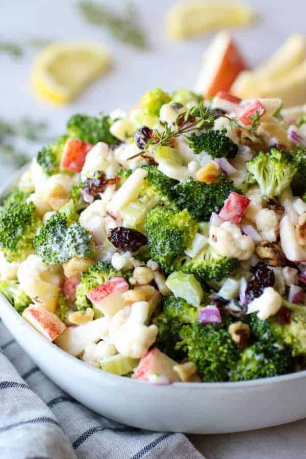 close up view of Apple Broccoli Cauliflower Salad in a white bowl