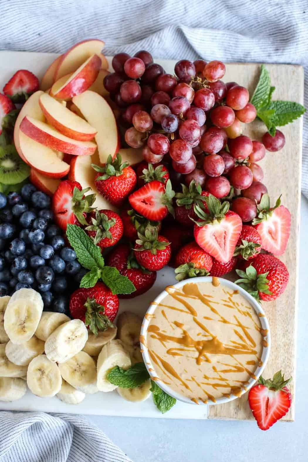 Aerial view of Easy Peanut Butter Yogurt Fruit Dip with platter of fresh fruit