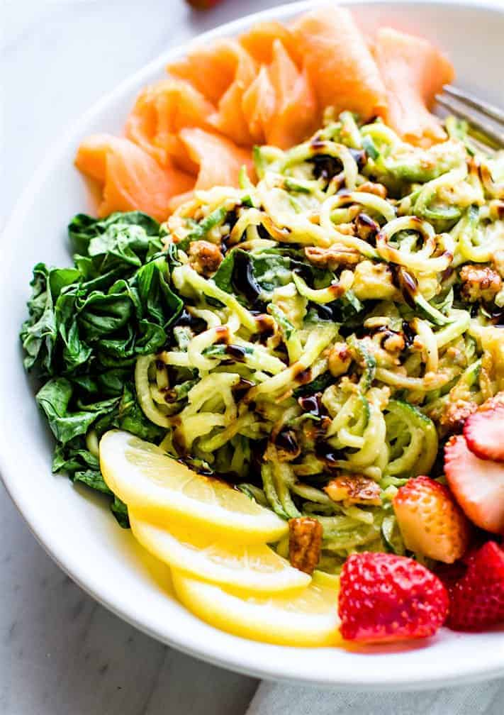 Smoked Salmon Strawberry Zucchini Noodle Pasta Salad in a white bowl
