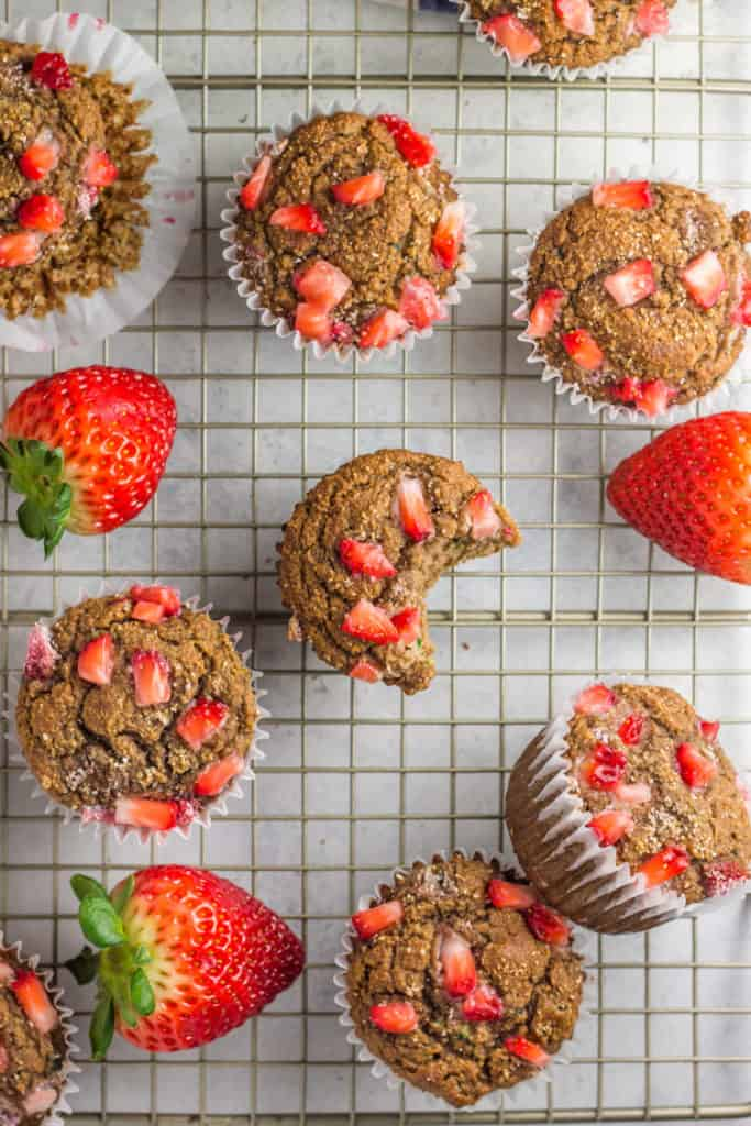 Almond Butter Strawberry Zucchini Muffins on a wire cooling rack