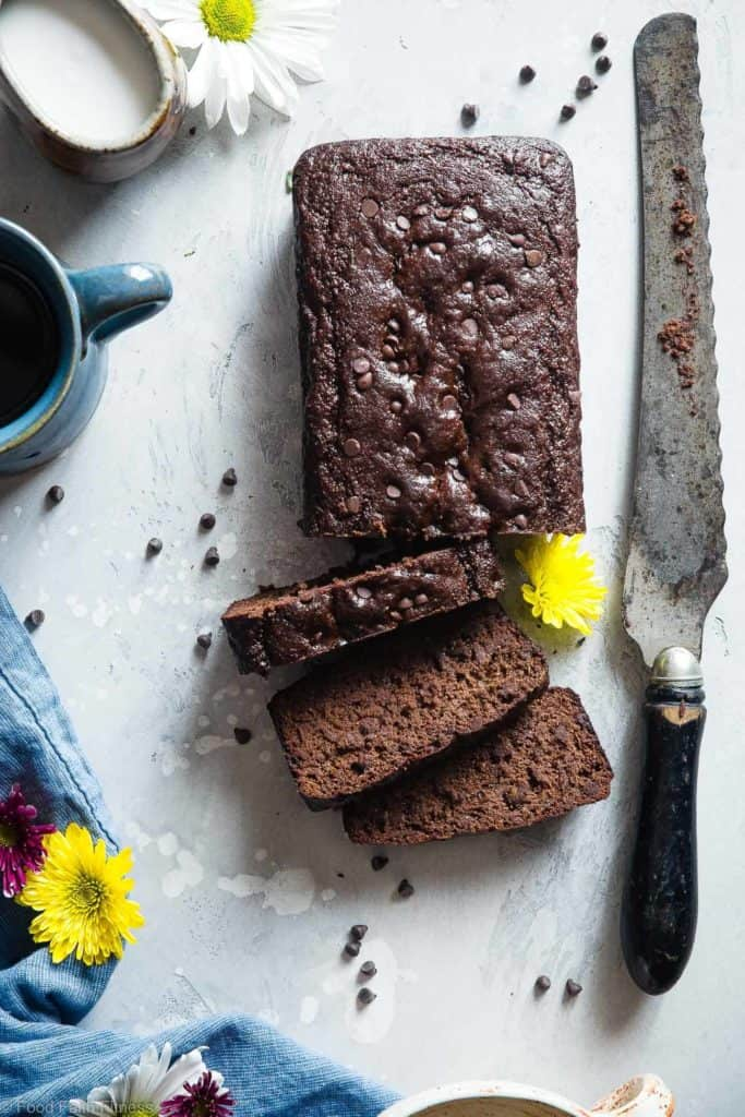 Healthy Paleo Chocolate Zucchini Bread sliced on a white table