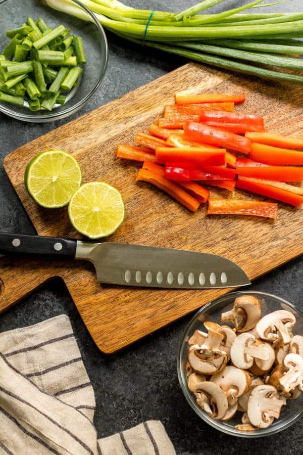 ingredients for the Whole30 Steak Stir-Fry on a cutting board