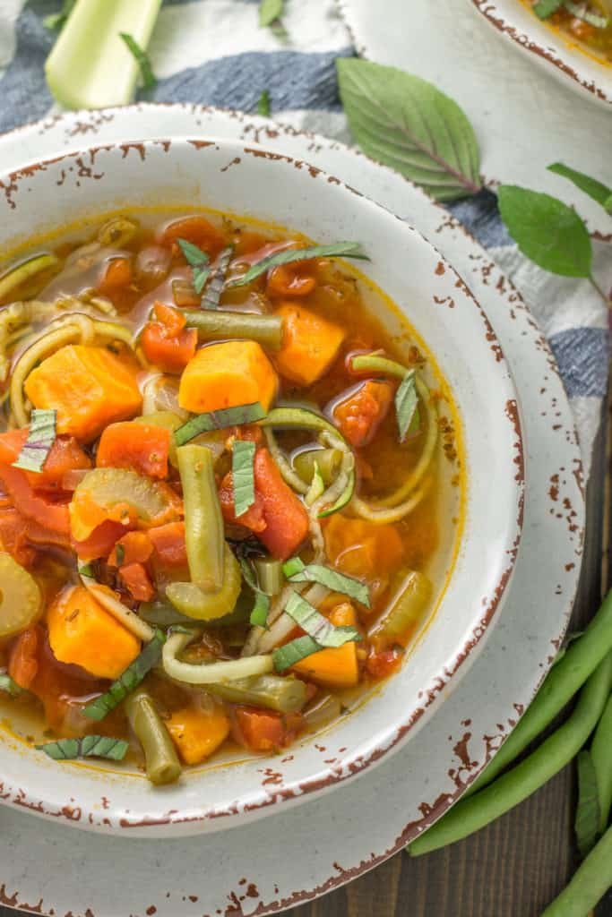 Whole30 Zoodle Minestrone Soup in a white bowl