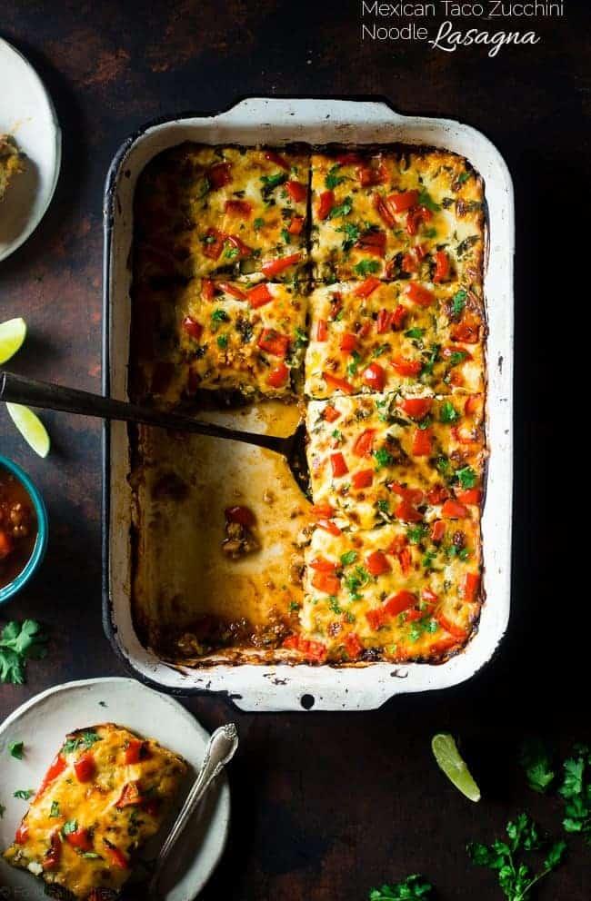 Mexican Zucchini Lasagna in a white casserole dish
