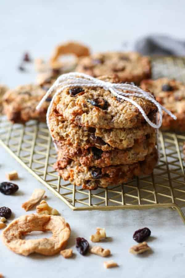 Four Apple Cinnamon Breakfast Oat Cookies stacked on a wire rack and tied with a string
