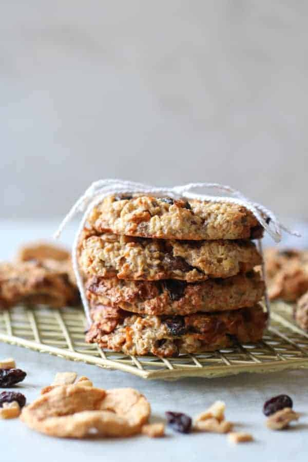 Four Apple Cinnamon Breakfast Oat Cookies stacked and tied together with a string on a wire cooling rack