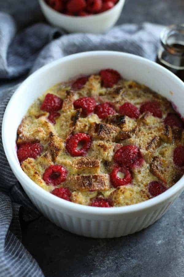 White souffle dish filled with Instant Pot Raspberry French Toast Casserole.