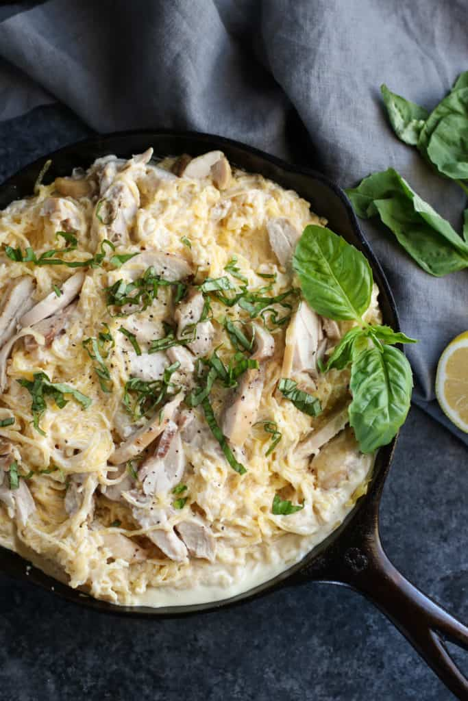 Aerial view of Dairy Free Spaghetti Squash Chicken Alfredo in a black skillet