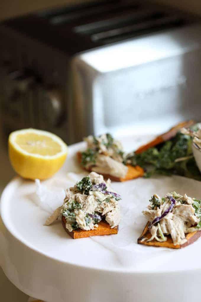 Caesar Chicken Salad on Sweet Potato Toast on a white plate