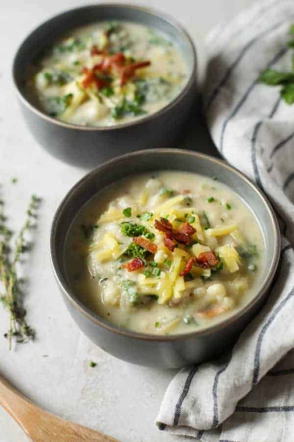 Aerial view of Loaded Cheesy Cauliflower Soup in bowls