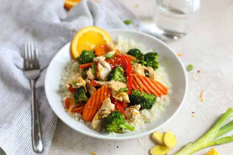 Orange-Ginger Chicken Stir Fry on a white plate
