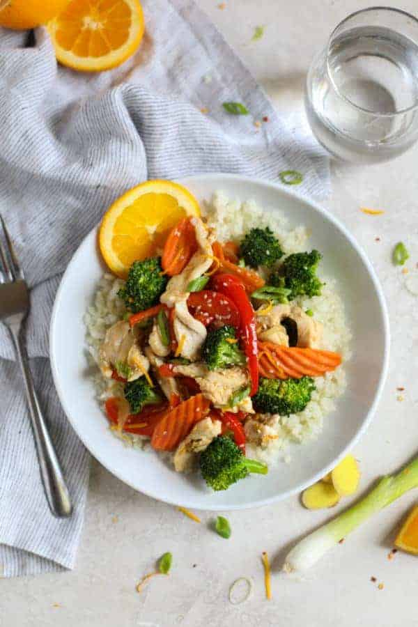 Overhead view of Orange-Ginger Chicken Stir Fry on a white plate