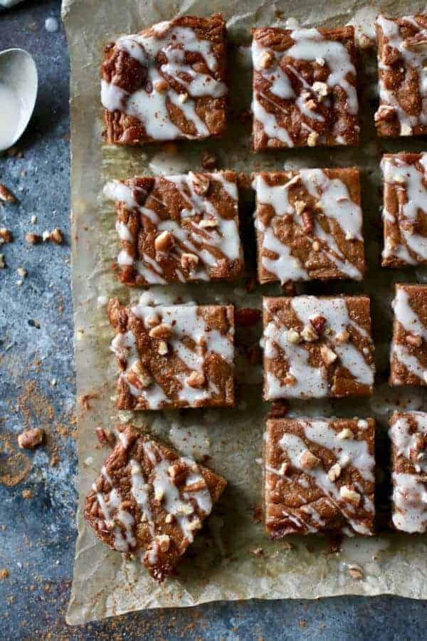 overhead view of Paleo Pumpkin Pie Bars cut into squares on wax paper