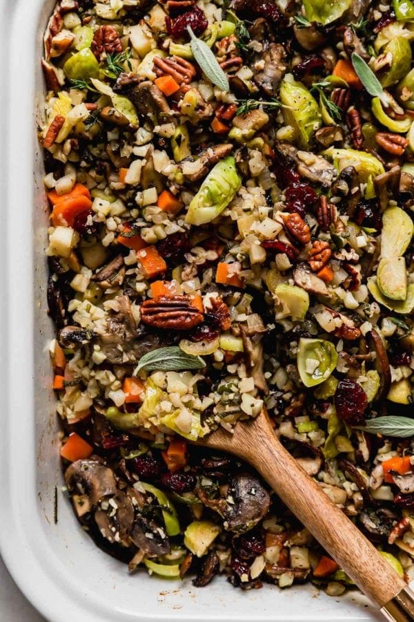 A close up view of cauliflower stuffing with pecans, brussels sprouts, and apples