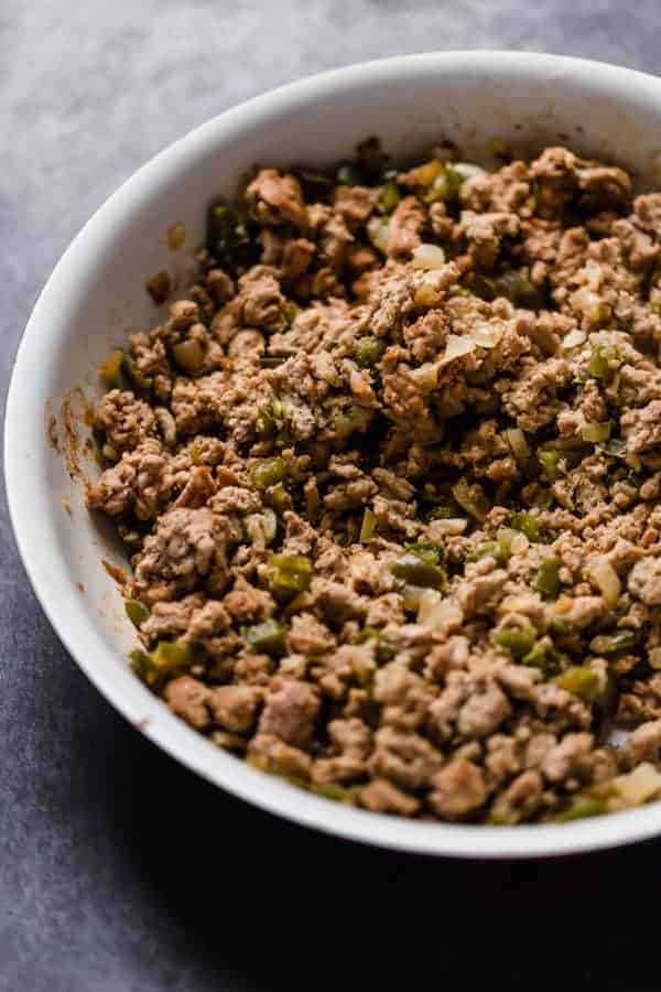 cooked ground turkey in a white bowl