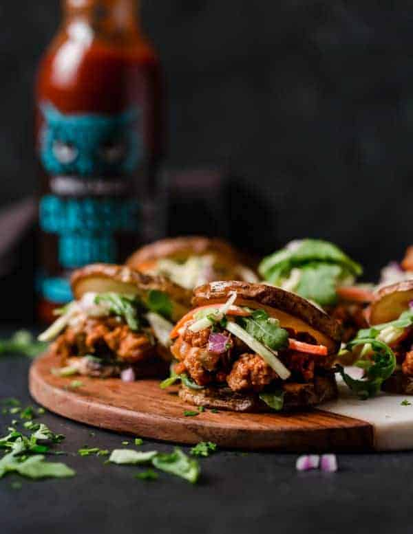 Close view of BBQ Turkey Sloppy Joes on a wooden tray