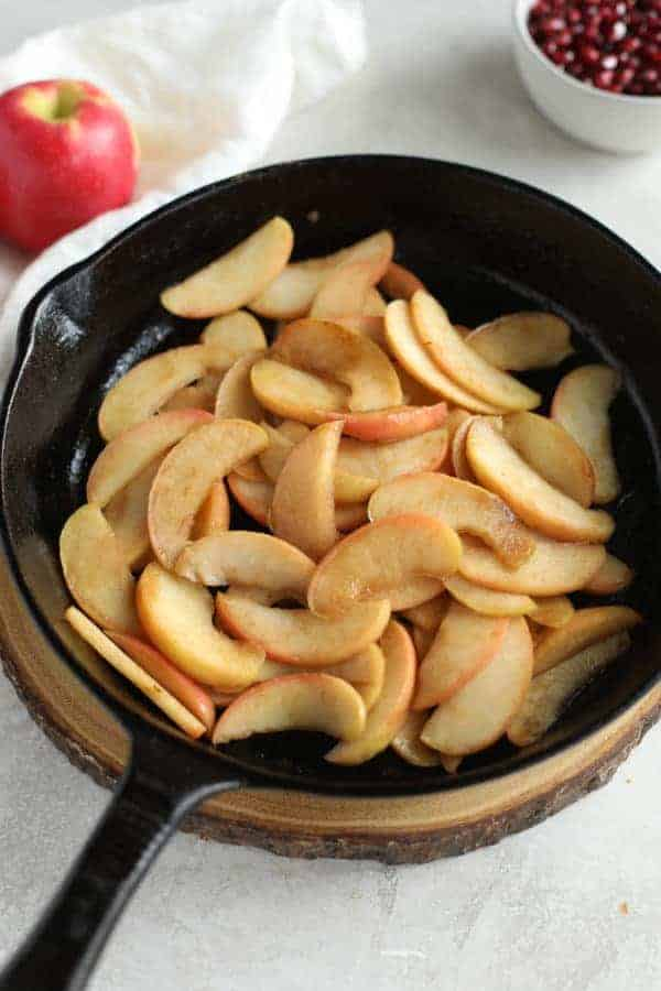 Overhead view of sliced apples in a skillet